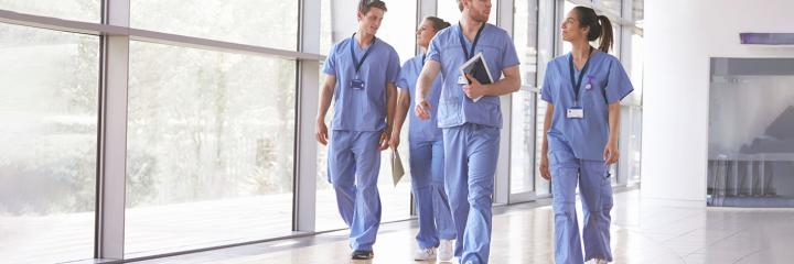 healthcare workers walking through hallway